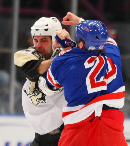 NEW YORK - DECEMBER 03: Eric Godard #28 of the Pittsburgh Penguins and Colton Orr #28 of the New York Rangers exchange first period punches on December 3, 2008 at Madison Square Garden in New York City. (Photo by Bruce Bennett/Getty Images)