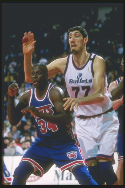 11 Apr 1997: Center Gheorghe Mursean of the Washington Bullets tries to guard forward Xavier McDaniel of the New Jersey Nets at the US Air Arena in Landover, Maryland. The Bullets won the game 109-90.