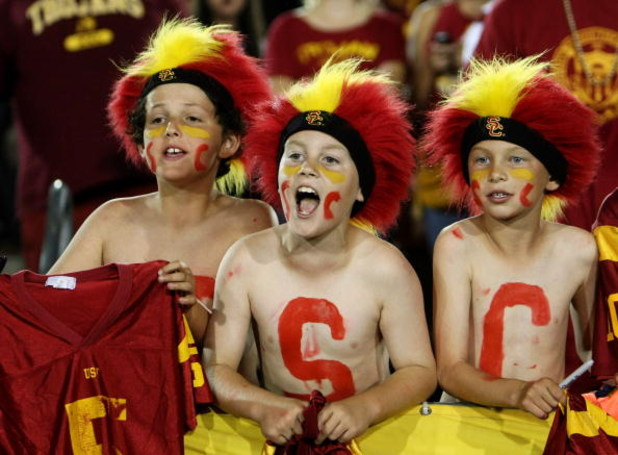 LOS ANGELES - SEPTEMBER 23:  Young USC Trojans fans yell in the game with the Washingotn State Cougars on September 23, 2009 at the Los Angeles Coliseum in Los Angeles, California.    (Photo by Stephen Dunn/Getty Images)