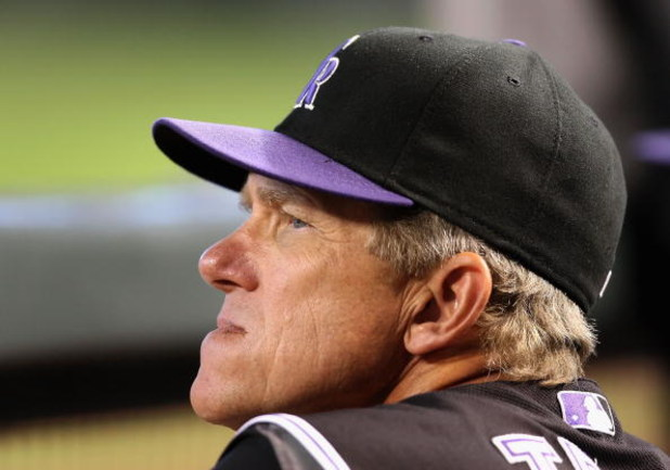 PHOENIX - SEPTEMBER 20:  Manager Jim Tracy of the Colorado Rockies watches from the dugout during the major league baseball game against the Arizona Diamondbacks at Chase Field on September 20, 2009 in Phoenix, Arizona.  (Photo by Christian Petersen/Getty
