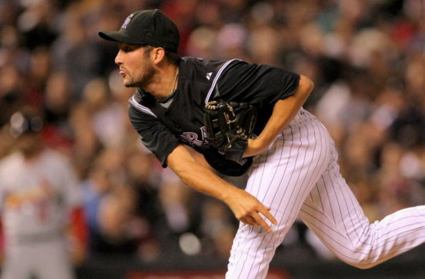 DENVER - SEPTEMBER 25:  Relief pitcher Huston Street #16 of the Colorado Rockies delivers against the St. Louis Cardinals at Coors Field on September 25, 2009 in Denver, Colorado. Street earned the win as the Rockies defeated the Cardinals 2-1.  (Photo by