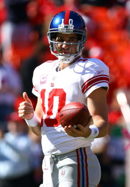 KANSAS CITY, MO - OCTOBER 04:  Quarterback Eli Manning #10 of the New York Giants gives a thumbs-up during pregame warm-ups just prior to the start of the game against the Kansas City Chiefs on October 4, 2009 at Arrowhead Stadium in Kansas City, Missouri