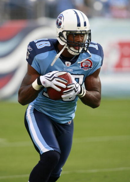 NASHVILLE, TN - SEPTEMBER 3: Kenny Britt #18 of the Tennessee Titans runs with the ball in warmups against the Green Bay Packers during a preseason NFL game at LP Field on September 3, 2009 in Nashville, Tennessee. The Titans beat the Packers 27-13. (Phot
