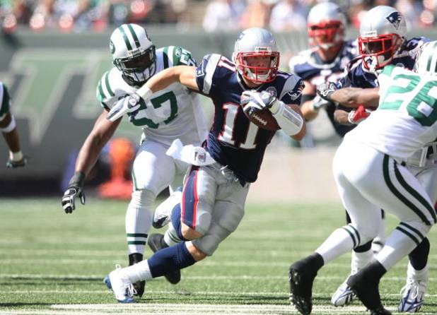 EAST RUTHERFORD, NJ - SEPTEMBER 20:  Julian Edelman #11 of the New England Patriots runs the ball against the New York Jets at Giants Stadium on September 20, 2009 in East Rutherford, New Jersey.  (Photo by Nick Laham/Getty Images)