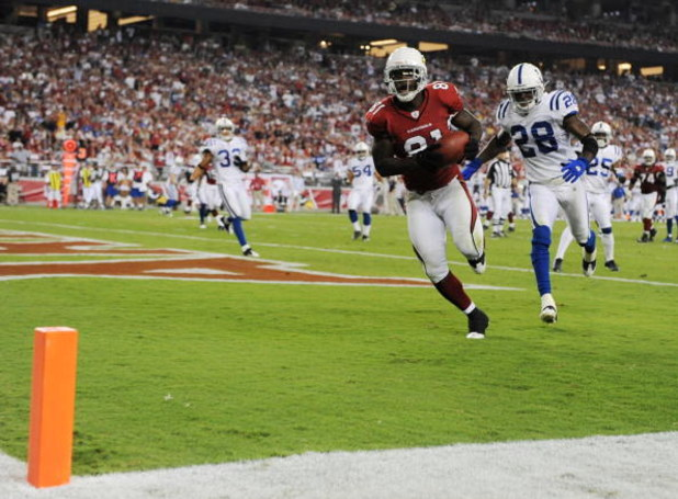 GLENDALE, AZ - SEPTEMBER 27:  Wide receiver Anquan Boldin #81 of the Arizona Cardinals runs into the endzone for a 10-yard touchdown in the third quarter against the Indianapolis Colts during the game at University of Phoenix Stadium on September 27, 2009