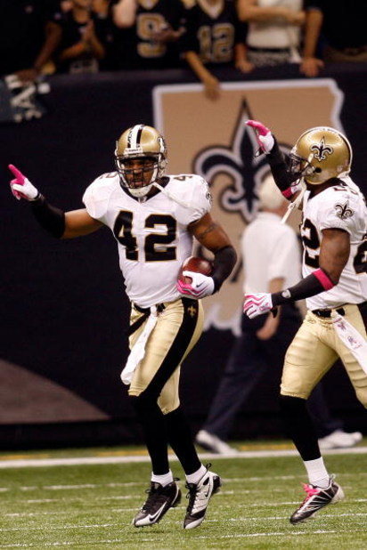 NEW ORLEANS - OCTOBER 04:  Darren Sharper #42 of the New Orleans Saints celebrates after scoring a touchdown on an interception against the New York Jets at the Louisana Superdome on October 4, 2009 in New Orleans, Louisiana.  (Photo by Chris Graythen/Get