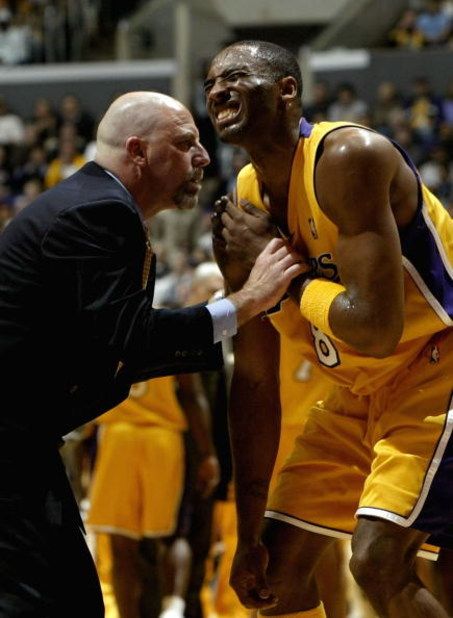 LOS ANGELES - JANUARY 12:  Trainer Gary Vitti examines an injury to the shoulder of Kobe Bryant #8 of the Los Angeles Lakers during the game against the Cleveland Cavaliers on January 12, 2004 at Staples Center in Los Angeles, California.  NOTE TO USER: U