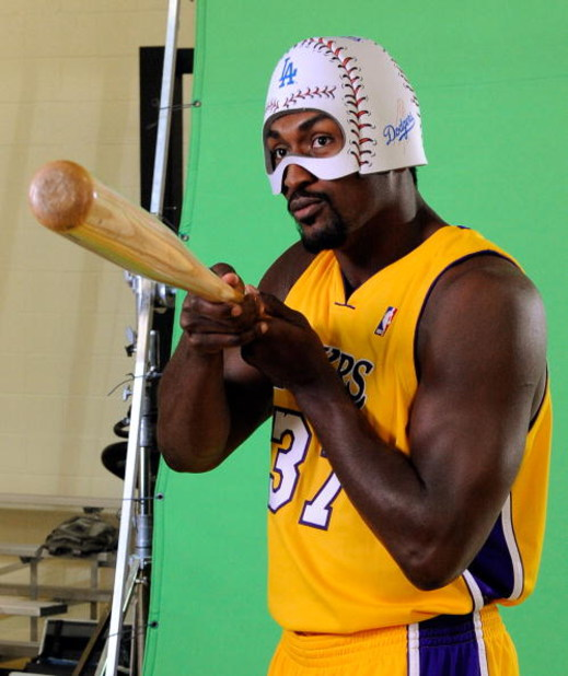 EL SEGUNDO, CA - SEPTEMBER 29: Ron Artest #37 of the Los Angeles Lakers holds a baseball bat and wears a mask while taping a public announcement for the Los Angeles Dodgers during Lakers media day at the Lakers training facility on September 29, 2009 in E