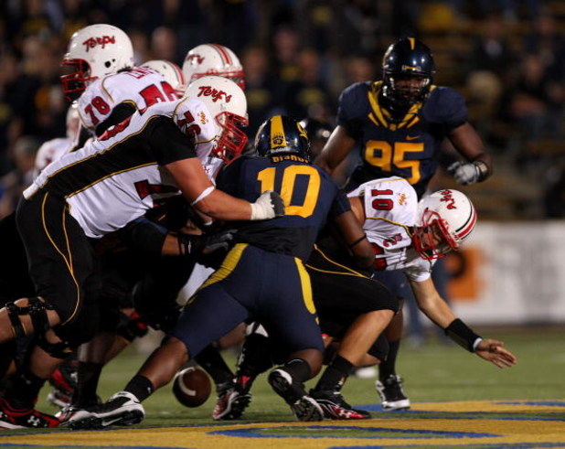 BERKELEY, CA - SEPTEMBER 05:  The California Golden Bears force Chris Turner #10 of the Maryland Terrapins to fumble the ball during the first half of their game at California Memorial Stadium on September 5, 2009 in Berkeley, California.  (Photo by Ezra