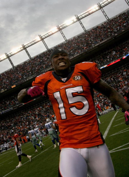 DENVER - OCTOBER 04:  Brandon Marshall #15 of the Denver Broncos celebrates after the final play against the Dallas Cowboys during NFL action at Invesco Field at Mile High on October 4, 2009 in Denver, Colorado. Marshall caught a game winning 51 yard rece