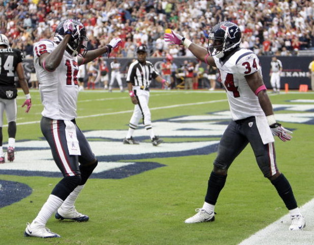 HOUSTON - OCTOBER 04:  Houston Texan Jacoby Jones #12 of the Houston Texans receives congratulations from teammate Dominique Barber #34 after his 95 yard kick return at Reliant Stadium on October 4, 2009 in Houston, Texas.  (Photo by Bob Levey/Getty Image