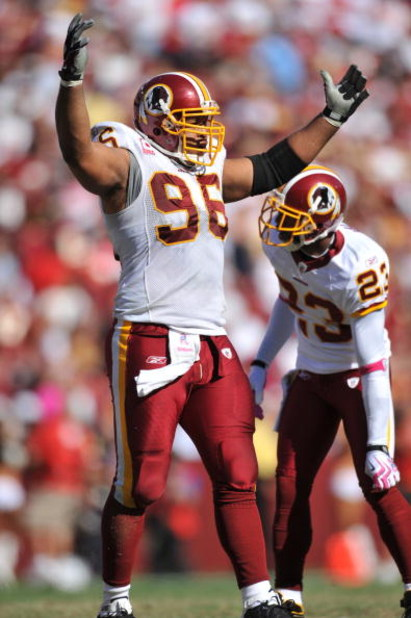 LANDOVER, MD - OCTOBER 4:  Cornelius Griffin #96 of the Washington Redskins rouses the crowd against the Tampa Bay Buccaneers at FedExField on October 4, 2009 in Landover, Maryland. The Redskins defeated the Buccaneers 16-13. (Photo by Larry French/Getty