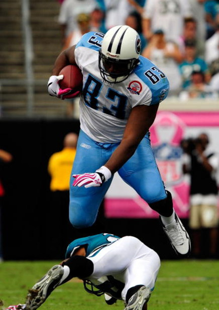 JACKSONVILLE, FL - OCTOBER 04:  Alge Crumpler #83 of the Tennessee Titans is tackled by Derek Cox #21 of the Jacksonville Jaguars at Jacksonville Municipal Stadium on October 4, 2009 in Jacksonville, Florida.  (Photo by Sam Greenwood/Getty Images)