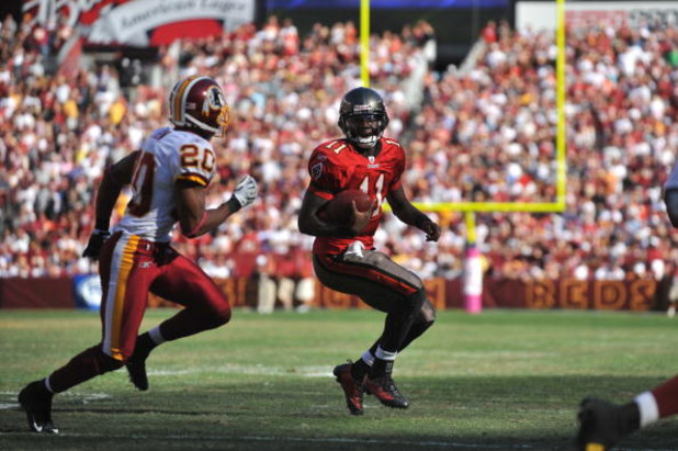 LANDOVER, MD - OCTOBER 4:  Josh Johnson #11 of the Tampa Bay Buccaneers runs the ball against the Washington Redskins at FedExField on October 4, 2009 in Landover, Maryland. The Redskins defeated the Buccaneers 16-13. (Photo by Larry French/Getty Images)