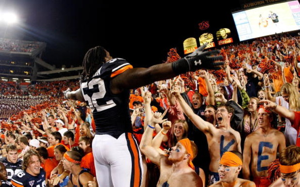 AUBURN, AL - SEPTEMBER 19:  Antonio Coleman #52 of the Auburn Tigers cheers with the fans against the West Virginia Mountaineers at Jordan-Hare Stadium on September 19, 2009 in Auburn, Alabama.  (Photo by Kevin C. Cox/Getty Images)