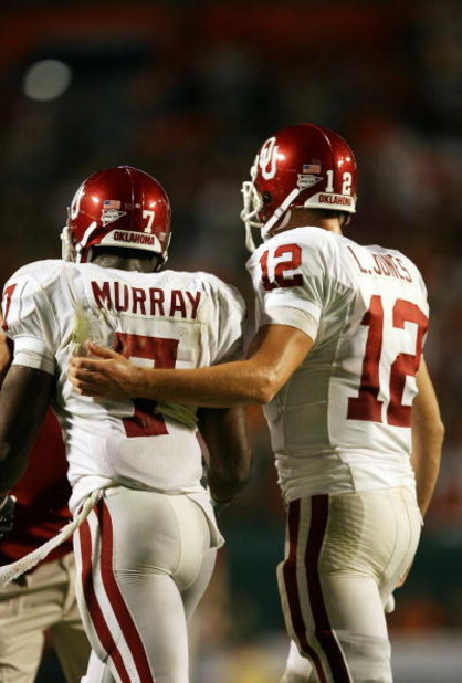 FORT LAUDERDALE, FL - OCTOBER 03: Quarterback Landry Jones #12 of the Oklahoma Sooners congratulates congratulates running back DeMarco Murray #7 after Murray's touchdown run in the third quarter against the Miami Hurricanes at Land Shark Stadium on Octob