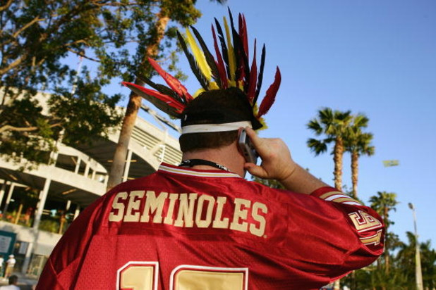 MIAMI GARDENS, FL - JANUARY 3:  A Florida State Seminoles fan talks on his cell phone before  the Fed Ex Orange Bowl with the Penn State Nittany Lions at Dolphins Stadium on January 3, 2005 in Miami Gardens, Florida. The Lions won 26-23 in triple overtime