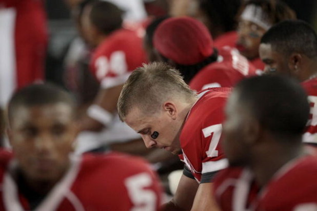 HOUSTON - SEPTEMBER 26: Quarterback Case Keenum #7 of the Houston Cougars sits on the bench while UH plays against the Texas Tech Red Raiders at Robertson Stadium on September 26, 2009 in Houston, Texas.  (Photo by Thomas B. Shea/Getty Images)