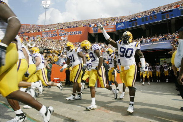 GAINESVILLE, FL - OCTOBER 7:   Charles Alexander #91, Chris Hawkins #29 and Ricky Jean-Francois #90 of the LSU Tigers run onto the field before the game against the Florida Gators at Ben Hill Griffin Stadium on October 7, 2006 in Gainesville, Florida. Flo