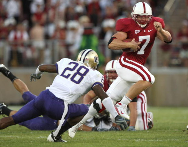 PALO ALTO, CA - SEPTEMBER 26:  Toby Gerhart #7 of the Stanford Cardinal runs for a touchdown against Tony Chidac #28 of the Washington Huskies at Stanford Stadium on September 26, 2009 in Palo Alto, California.  (Photo by Jed Jacobsohn/Getty Images)