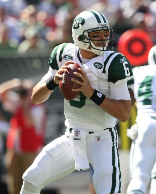 EAST RUTHERFORD, NJ - SEPTEMBER 20:  Mark Sanchez #6 of the New York Jets drops back to pass against the New England Patriots at Giants Stadium on September 20, 2009 in East Rutherford, New Jersey.  (Photo by Nick Laham/Getty Images)