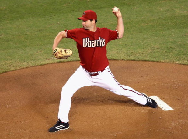 PHOENIX - SEPTEMBER 22:  Starting pitcher Doug Davis #49 of the Arizona Diamondbacks pitches against the San Francisco Giants during the major league baseball game at Chase Field on September 22, 2009 in Phoenix, Arizona.  (Photo by Christian Petersen/Get