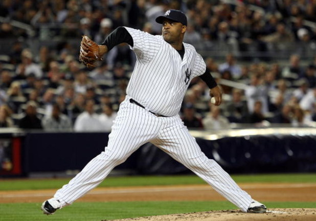 NEW YORK - OCTOBER 07:  Starting pitcher CC Sabathia #52 of the New York Yankees deals against the Minnesota Twins in Game One of the ALDS during the 2009 MLB Playoffs at Yankee Stadium on October 7, 2009 in the Bronx borough of New York City.  (Photo by