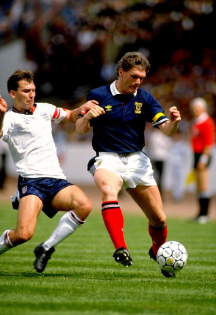 27 May 1989:  Scotland Captain Roy Aitken takes on England Captain Bryan Robson during the Rous Cup match at Hampden Park in Glasgow, Scotland. England won the match 2-0. \ Mandatory Credit: Dave  Cannon/Allsport