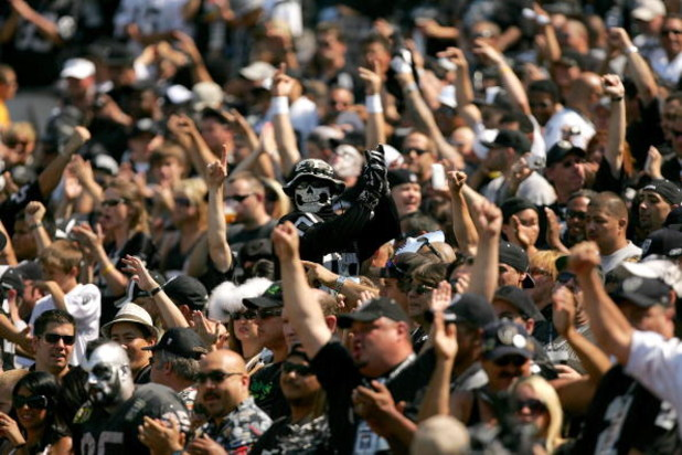 OAKLAND, CA - SEPTEMBER 27:  Oakland Raiders fans cheer for their team before their game against the Denver Broncos at the Oakland-Alameda County Coliseum on September 27, 2009 in Oakland, California.  (Photo by Ezra Shaw/Getty Images)