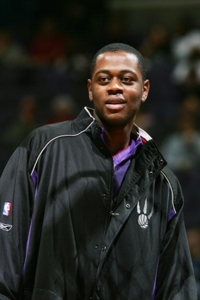 WASHINGTON DC - NOVEMBER 23:  Jerome Moiso #6 of the Toronto Raptors looks on before playing against the Washington Wizards during NBA action on November 23, 2004 at the MCI Center in Washington D.C.  The Wizards won 102-86. NOTE TO USER:  User expressly