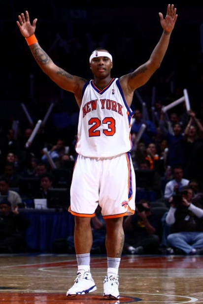 NEW YORK - JANUARY 14:  Quentin Richardson #23 of the New York Knicks celebrates a teammate's basket in the final minutes against the Washington Wizards at Madison Square Garden January 14, 2009 in New York City. NOTE TO USER: User expressly acknowledges