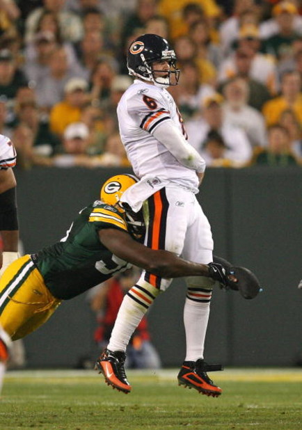 GREEN BAY, WI - SEPTEMBER 13: Jay Cutler #6 of the Chicago Bears is hit by Michael Montgomery #96 of the Green Bay Packers after passing the ball on September 13, 2009 at Lambeau Field in Green Bay, Wisconsin. The Packers defeated the Bears 21-15. (Photo