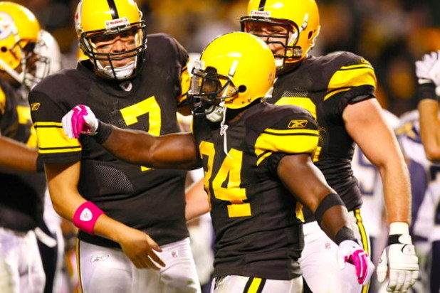 PITTSBURGH - OCTOBER 4:  Running back Rashard Mendenhall #34 of the Pittsburgh Steelers celebrates his two-yard touchdown run with teammates Ben Roethlisberger #7 and Justin Hartwig #62 against the San Diego Chargers in the second quarter at Heinz Field o