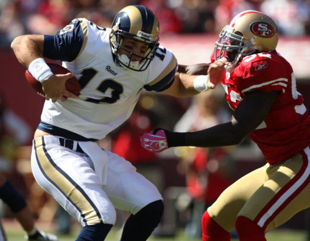 SAN FRANCISCO - OCTOBER 04:  Patrick Willis #52 of the San Francisco 49ers sacks Kyle Boller #12 of the St. Louis Rams during an NFL game on October 4, 2009 at Candlestick Park in San Francisco, California.  (Photo by Jed Jacobsohn/Getty Images)