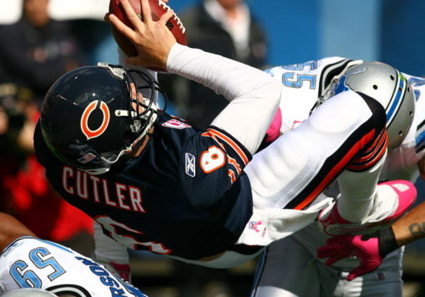 CHICAGO - OCTOBER 04: Jay Cutler #6 of the Chicago Bears flips into the end zone for a touchdown against the Detroit Lions on October 4, 2009 at Soldier Field in Chicago, Illinois. The Bears defeated the Lions 48-24. (Photo by Jonathan Daniel/Getty Images