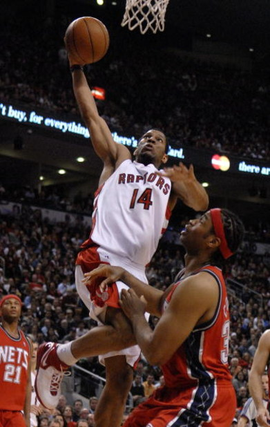 TORONTO- MAY 1:   Joey Graham #13 of the Toronto Raptors gets one up on Jason Collins #35 of the New Jersey Nets in Game Five of the Eastern Conference Quarterfinals during the 2007 NBA Playoffs at Air Canada Centre on May 1, 2007 in Toronto, Ontario, Can