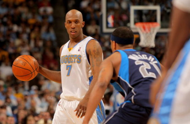 DENVER - MAY 03:  Chauncey Billups #7 of the Denver Nuggets controls the ball as Antoine Wright #21 of the Dallas Mavericks defends in Game One of the Western Conference Semifinals during the 2009 NBA Playoffs at Pepsi Center on May 3, 2009 in Denver, Col