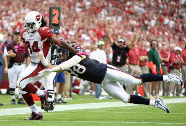 GLENDALE, AZ - OCTOBER 11:  Runningback Tim Hightower #34 of the Arizona Cardinals rushes the ball past Connor Barwin #98 of the Houston Texans during the NFL game at the Universtity of Phoenix Stadium on October 11, 2009 in Glendale, Arizona. The Cardina