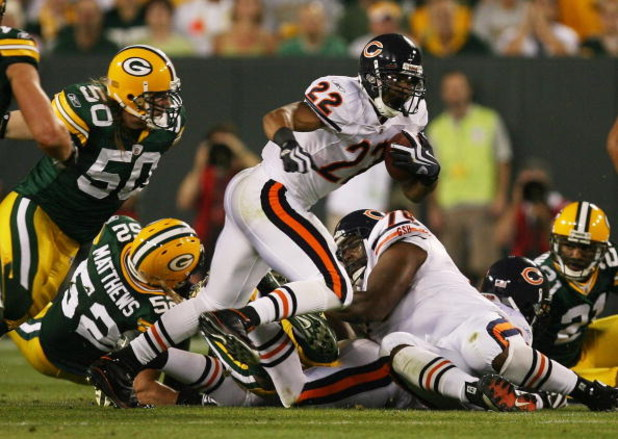 GREEN BAY, WI - SEPTEMBER 13: Matt Forte #22 of the Chicago Bears tries to gain yardage as A.J. Hawk #50 of the Green Bay Packers chases him on September 13, 2009 at Lambeau Field in Green Bay, Wisconsin. The Packers defeated the Bears 21-15.  (Photo by J