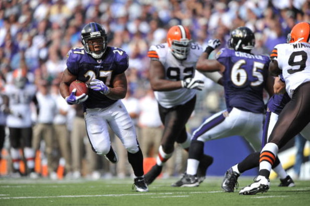 BALTIMORE - SEPTEMBER 27:  Ray Rice #27 of the Baltimore Ravens runs the ball for his first career touchdown against the Cleveland Browns at M&T Bank Stadium on September 27, 2009 in Baltimore, Maryland. The Ravens defeated the Browns 34-3. (Photo by Larr