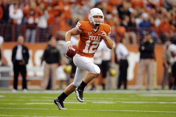 AUSTIN, TX - OCTOBER 10:  Quarterback Colt McCoy #12 of the Texas Longhorns looks for a receiver against the Colorado Buffaloes on October 10, 2009 at Darrell K Royal-Texas Memorial Stadium in Austin, Texas.  Texas won 38-14.  (Photo by Brian Bahr/Getty I