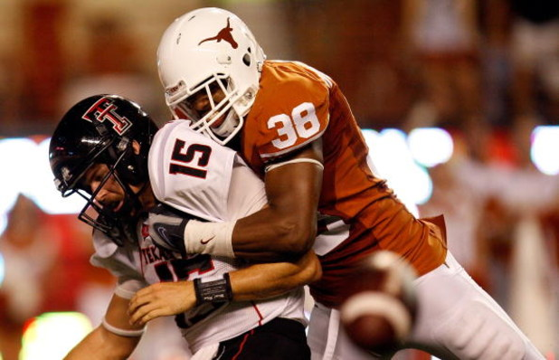 AUSTIN, TX - SEPTEMBER 19:  Quarterback Taylor Potts #15 of the Texas Tech Red Raiders is sacked by Roddrick Muckelroy #38 of the Texas Longhorns at Darrell K Royal-Texas Memorial Stadium on September 19, 2009 in Austin, Texas.  (Photo by Ronald Martinez/