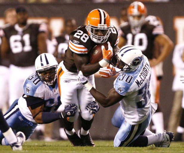 CLEVELAND - AUGUST 29:  James Davis #28 of the Cleveland Browns is hit by David Thornton #50 and Jason McCourty #30 of the Tennessee Titans at Cleveland Browns Stadium on August 29, 2009 in Cleveland, Ohio.  (Photo by Matt Sullivan/Getty Images)