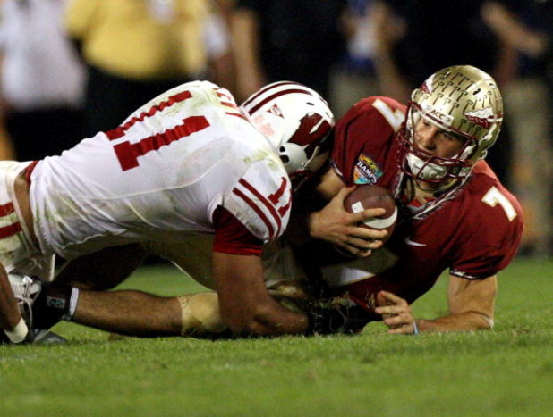 ORLANDO, FL - DECEMBER 27:  Quarterback Christian Ponder #7 of the Florida State Seminoles is sacked by DeAndre Levy #11 of the Wisconsin Badgers during the Champs Bowl on December 27, 2008 at the Citrus Bowl in Orlando, Florida.  (Photo by Sam Greenwood/