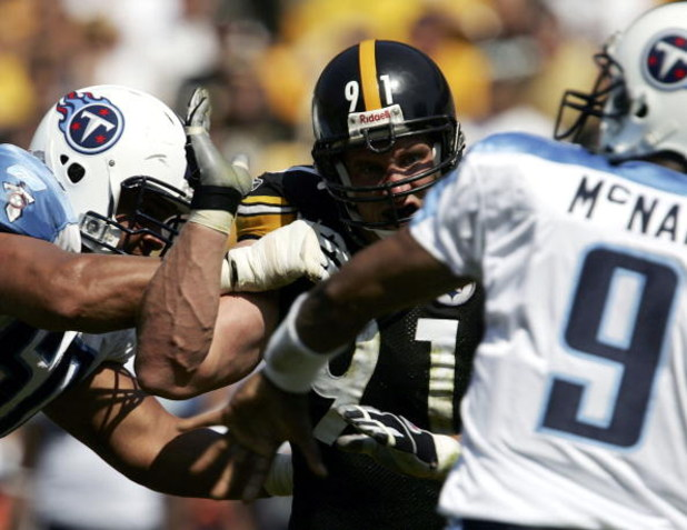 PITTSBURGH - SEPTEMBER 11: Aaron Smith #91 of the Pittsburgh Steelers rushes quarterback Steve McNair #9 of the Tennessee Titans as tackle Jacob Bell #60 attempts to block on September 11, 2005 at Heinz Field in Pittsburgh, Pennsylvania. The Steelers defe
