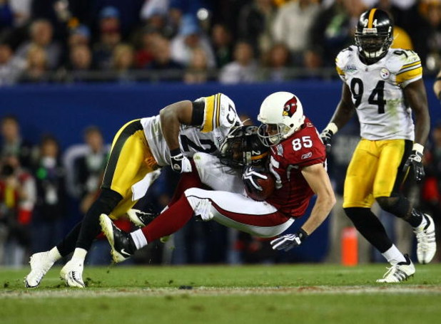 TAMPA, FL - FEBRUARY 01:  Jerheme Urban #85 of the Arizona Cardinals makes a reception in the fourth quarter as he is hit by Ryan Clark #25 of the Pittsburgh Steelers during Super Bowl XLIII on February 1, 2009 at Raymond James Stadium in Tampa, Florida.