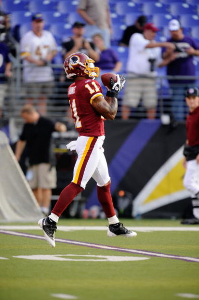 BALTIMORE, MD - AUGUST 13:  Devin Thomas #11 of the Washington Redskins makes a catch during warm ups of a NFL preseason football game against the Baltimore Ravens on August 13, 2009 at M & T Bank Stadium in Baltimore, Maryland.   (Photo by Mitchell Layto