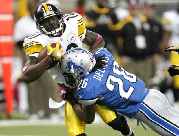 DETROIT , MI - OCTOBER 11: Santonio Holmes #10 of the Pittsburgh Steelers is tackled after making a second quarter catch by Louis Delmas #28 of the Detroit Lions on October 11, 2009 at Ford Field in Detroit, Michigan.  (Photo by Gregory Shamus/Getty Image