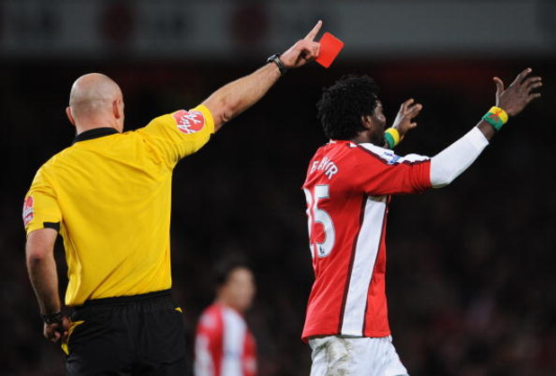 LONDON - DECEMBER 21:  Emmanuel Adebayor of Arsenal reacts as he is sent off by referee Howard Webb during the Barclays Premier League match between Arsenal and Liverpool at the Emirates Stadium on December 21, 2008 in London, England.  (Photo by Clive Ma