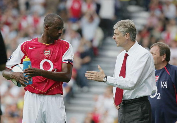 LONDON - SEPTEMBER 11:  Arsene Wenger of Arsenal talks with Patrick Vieira during the Barclays Premiership match between Fulham and Arsenal at Craven Cottage on September 11, 2004 in London.  (Photo by Phil Cole/Getty Images)